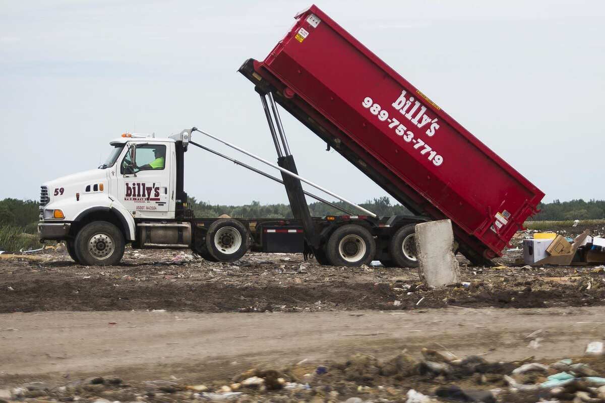 A Billy's waste removal truck dumps refuse at the Midland City Landfill in 2017.