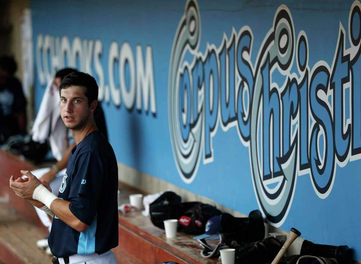 Corpus Christi Hooks outfielder Kyle Tucker (12) in the dugout during the third inning of the Hooks minor league game at Whataburger Field, Sunday, June, 25, 2017. ( Karen Warren / Houston Chronicle )
