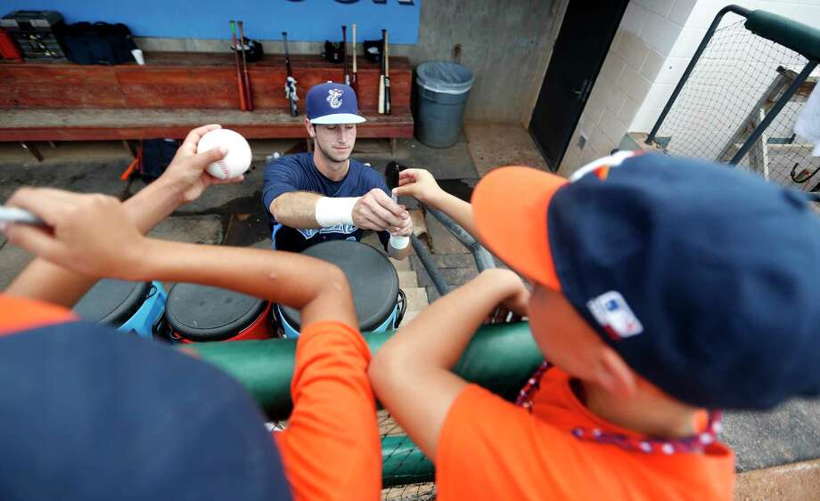 Corpus Christi Hooks outfielder Kyle Tucker (12) signs autographs for kids before the start of the Hooks minor league game at Whataburger Field, Sunday, June, 25, 2017.  ( Karen Warren / Houston Chronicle ) Photo: Karen Warren, Staff Photographer / 2017 Houston Chronicle