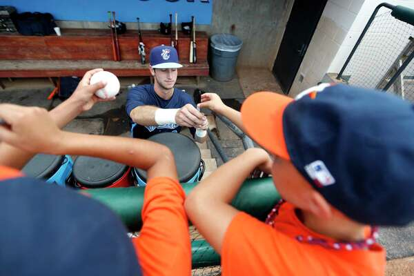 c1bad00761aa34 1of4Corpus Christi Hooks outfielder Kyle Tucker (12) signs autographs for  kids before the start of the Hooks minor league game at Whataburger Field,  Sunday, ...