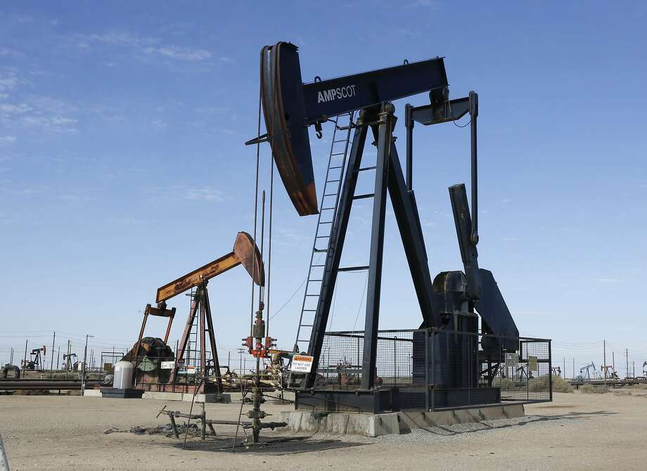 In this Aug. 4, 2013, file photo, an oil field pump jack operates near Lost Hills (Kern County). California's cap-and-trade law survived a legal challenge Wednesday when the Supreme Court declined to hear a case. Photo: Rich Pedroncelli, Associated Press