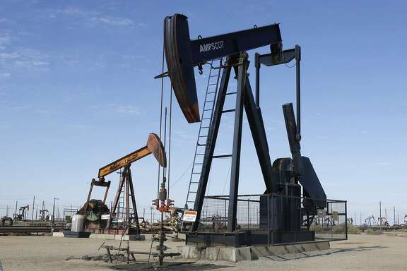 FILE -- In this Aug. 4, 2013, file photo, an oil field pump jack operates near Lost Hills, Calif. California's cap-and-trade law, which puts a cap and a price on carbon emissions, expires in 2020. Gov. Jerry Brown say he's still hopeful it will be extended, after he failed to convince lawmakers to extend it in tandem with the just-passed state budget. (AP Photo/Rich Pedroncelli, File)