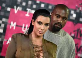 """FILE - In this Aug. 30, 2015, file photo, Kim Kardashian, left, and Kanye West arrive at the MTV Video Music Awards at the Microsoft Theater in Los Angeles. Kardashian praised her husband's May 19, 2016, appearance on """"The Ellen DeGeneres Show"""" on Twitter. (Photo by Jordan Strauss/Invision/AP, File)"""