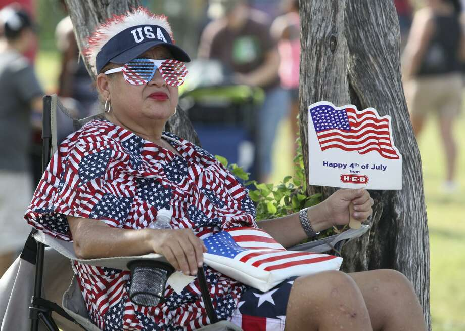 Sovia Lauriano fans herself while waiting for the fireworks to start July 4, 2012, at Woodlawn Lake Park. Lauriano said she dresses up every year and always tries to be patriotic. Photo: Express-News File Photo / SAN ANTONIO EXPRESS-NEWS