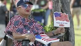 Sovia Lauriano fans herself while waiting for the fireworks to start July 4, 2012, at Woodlawn Lake Park. Lauriano said she dresses up every year and always tries to be patriotic.