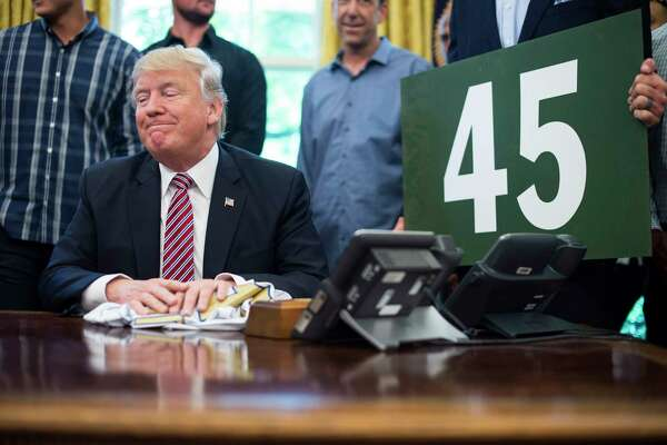 President Trump pauses as he is asked a question on health care as he meets with members of the 2016 World Series Champions Chicago Cubs in the Oval Office of the White House in Washington on Wednesday.