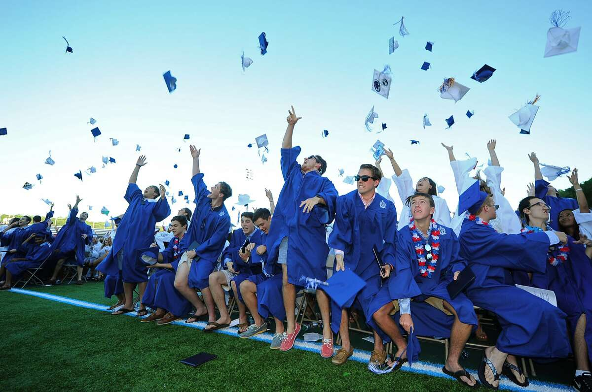 Wilton High School Class of 2017 celebrate their commencement exercises Saturday, June 24, 2017, at the school's Fujitani Field in Wilton, Conn.