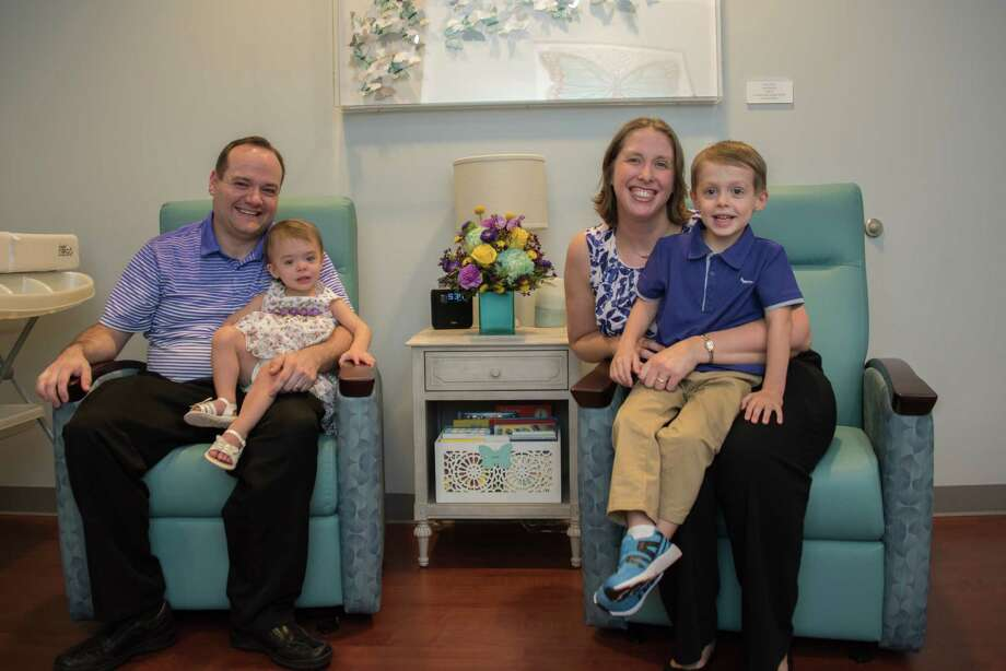 Phillip Hurlbut and Katie Hurlbut sit with their children Anna and Luke in the new Texas Children's Hospital Pavilion for Women NICU Butterfly Bereavement Room during theblessing and dedication ceremony to celebrate its grand opening on Thursday, June 22. Photo: C.J. Lee, Texas Children's Hospital