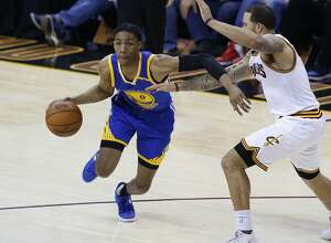 Golden State Warriors guard Patrick McCaw (0) drives on Cleveland Cavaliers guard Deron Williams (31) in the second half of Game 4 of basketball's NBA Finals in Cleveland, Friday, June 9, 2017. (AP Photo/Ron Schwane)