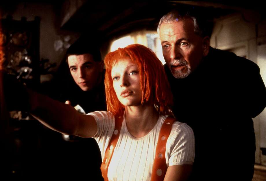 THE FIFTH ELEMENT (1997) -- (l-r) Lee Evans, Mila Jovovich and Ian Holm starred in the 1997 film   The Fifth Element from Columbia/Tristar.  photo credit:   Jack English.  HOUCHRON CAPTION (06/29/2005) SECSTAR COLOR:  THE RED DREAD: Only this muppetheaded waif can save the world from Evil in Luc Besson's hyperkinetic fantasia. Hey, it beats spinning plates. Photo: Jack English, Columbia/Tristar