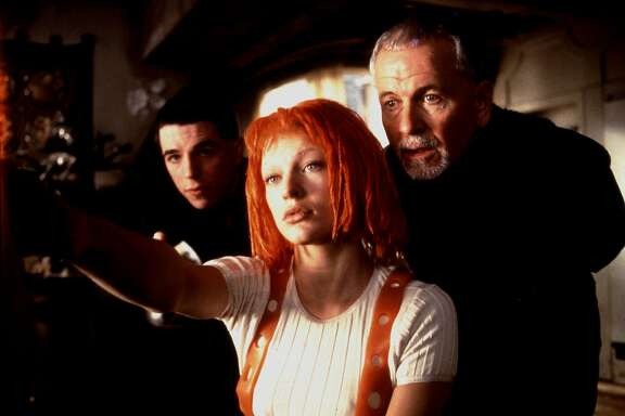 THE FIFTH ELEMENT (1997) -- (l-r) Lee Evans, Mila Jovovich and Ian Holm starred in the 1997 film   The Fifth Element from Columbia/Tristar.  photo credit:   Jack English.  HOUCHRON CAPTION (06/29/2005) SECSTAR COLOR:  THE RED DREAD: Only this muppetheaded waif can save the world from Evil in Luc Besson's hyperkinetic fantasia. Hey, it beats spinning plates.