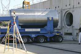 In this June 15, 2012 photo released by Dominion Resources, a spent fuel storage container is offloaded from a trailer into a horizontal storage module at the Millstone Power Station in Waterford, Conn. With the collapse of a proposal for nuclear waste storage at Nevadas Yucca Mountain, Millstone and other plants across the country are building or expanding on-site storage for waste.