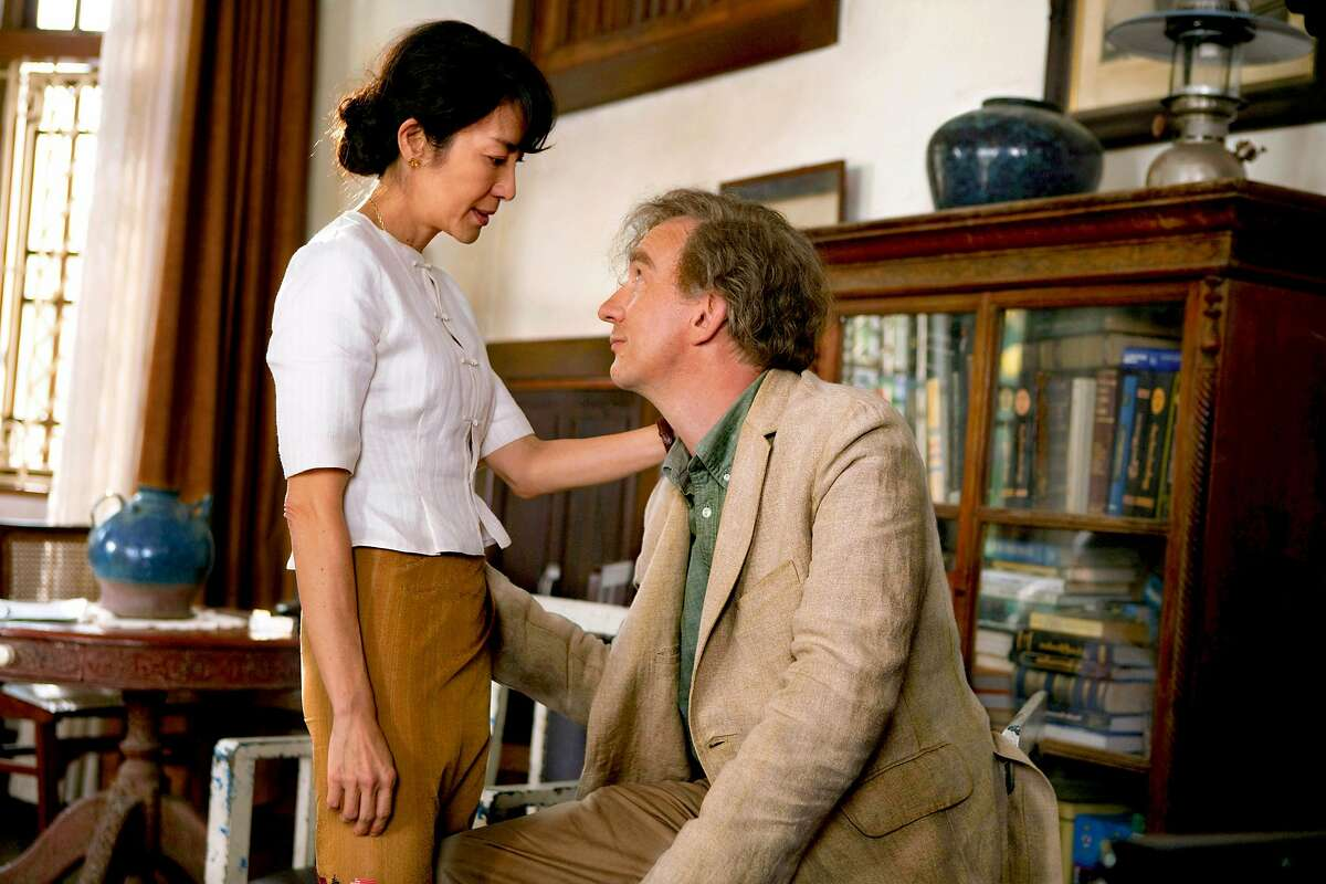 """Michelle Yeoh, left, and David Thewlis appear in a scene from, """"The Lady."""""""