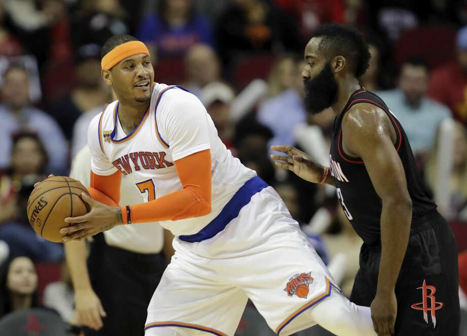HOUSTON, TX - DECEMBER 31: Carmelo Anthony #7 of the New York Knicks controls the ball defended by James Harden #13 of the Houston Rockets in the first half at Toyota Center on December 31, 2016 in Houston, Texas. NOTE TO USER: User expressly acknowledges and agrees that, by downloading and or using this photograph, User is consenting to the terms and conditions of the Getty Images License Agreement. (Photo by Tim Warner/Getty Images) Photo: Tim Warner/Getty Images