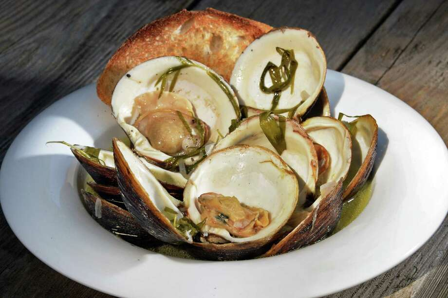 Tarragon garlic shallot clams for Caroline Barrett's Bold Flavors series Thursday June 22, in Delmar, NY.  (John Carl D'Annibale / Times Union) Photo: John Carl D'Annibale / 20040828A