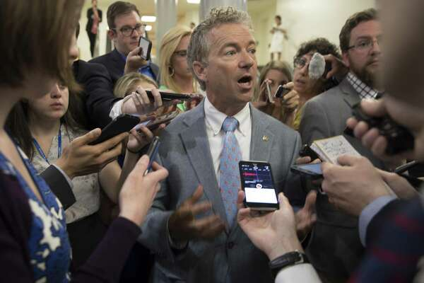 Sen. Rand Paul, R-Kentucky, who opposes current Senate health care bill, comments on its Congressional Budget Office score on Monday. Paul is among a handful of Republicans who imperil the measure's chances of success. Part of the reason is that it may not be true to conservative principles.