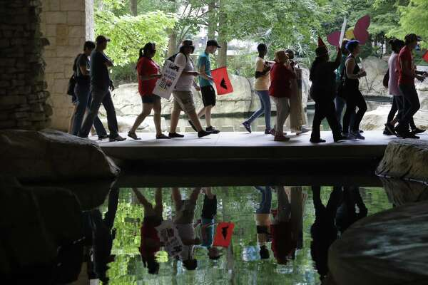 """Protesters march Monday to oppose a new Texas """"sanctuary cities"""" bill that aligns with the president's tougher stance on illegal immigration in San Antonio. LULAC will have its convention in San Antonio beginning Tuesday, partly to bring awareness of such topics to Texans."""