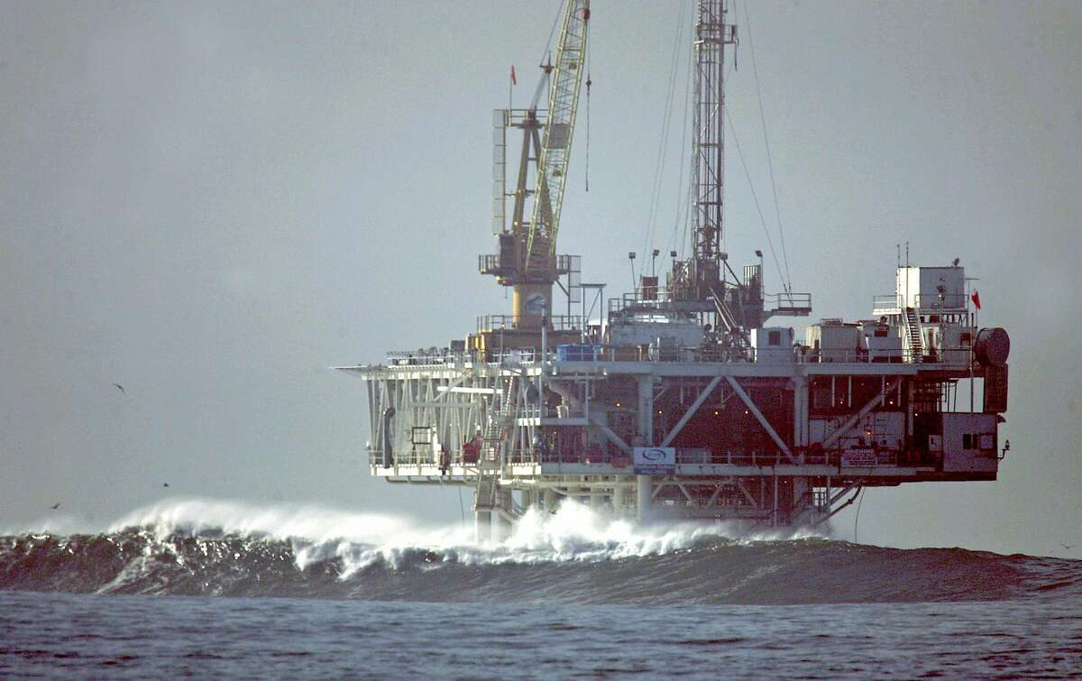 Opposition in California is nothing new. Waves break by an oil platform offshore from Seal Beach, Calif., in this Dec. 21, 2005 file photo. Gov. Arnold Schwarzenegger disagrees with calls by President George W. Bush and Republican presidential candidate John McCain to lift a ban on new oil drilling in coastal waters.