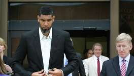 Retired Spurs player Tim Duncan, left, leaves the John H. Wood Jr. Federal Courthouse with his lawyers after the sentencing of his former financial advisor Charles Banks, on Wednesday, June 28, 2017.
