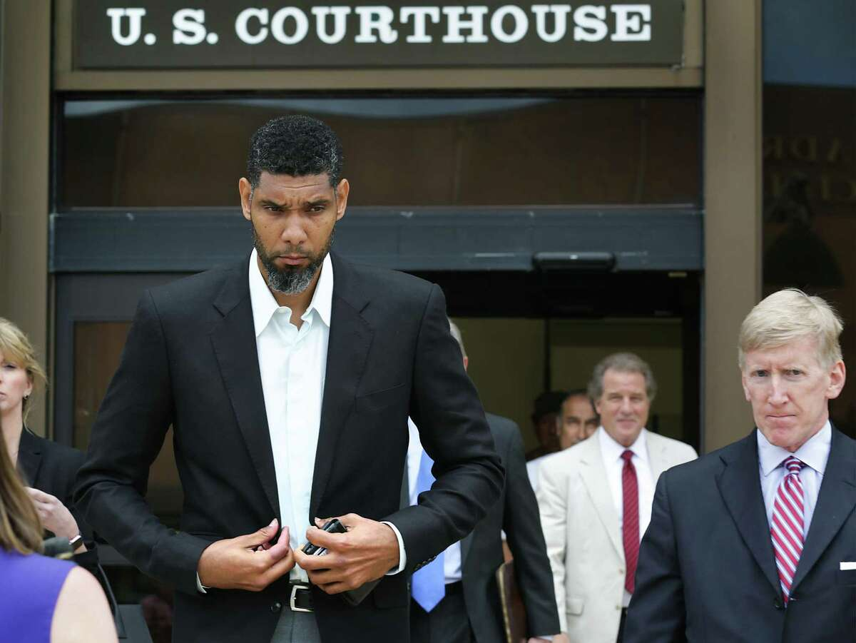 Retired Spurs player Tim Duncan leaves the John H. Wood Jr. Federal Courthouse with his lawyers after the June 2017 sentencing of former financial adviser Charles Banks.