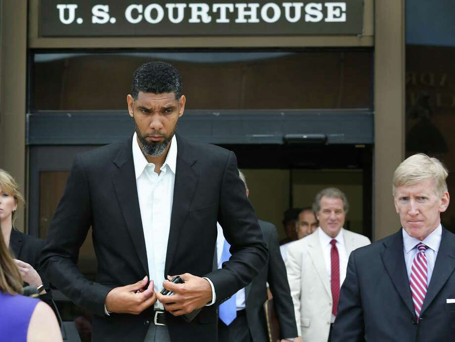 Retired Spurs player Tim Duncan leaves the John H. Wood Jr. Federal Courthouse with his lawyers after the June 2017 sentencing of former financial adviser Charles Banks. Photo: Bob Owen /Staff File Photo / ©2017 San Antonio Express-News
