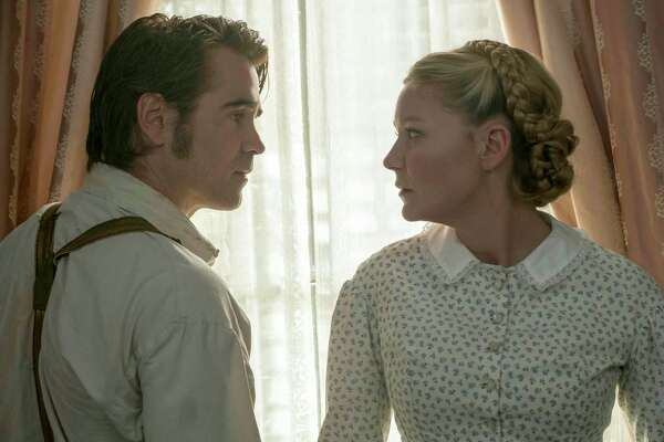 """This image released by Focus Features shows Colin Farrell, left, and Kirsten Dunst in a scene from """"The Beguiled."""" (Ben Rothstein/Focus Features via AP) ORG XMIT: NYET137"""