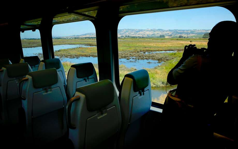 A media member takes photos of the views along the route aboard the SMART train as it leaves the Petaluma train station en route to the San Rafael station during a demonstration run. Photo: Michael Macor, The Chronicle