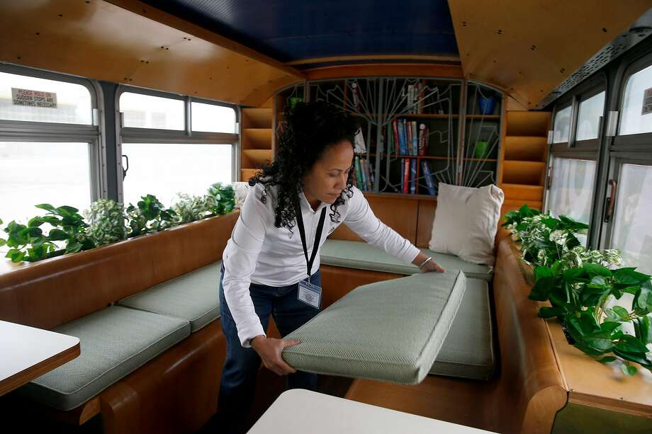 Bus operator and teacher's assistant Katie J. Leasau prepares a mobile classroom for its debut. Photo: Paul Chinn, The Chronicle