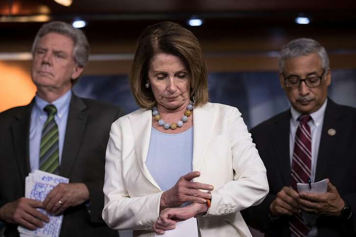 WASHINGTON, DC - JUNE 27: Flanked by members of the House Democratic leadership, House Minority Leader Nancy Pelosi (D-CA) checks her watch during a press conference about the GOP health care bill on Capitol Hill, June 27, 2017 in Washington, DC. The Senate GOP announced earlier in the day that they will delay a vote on their health care bill until after the July 4 recess. (Photo by Drew Angerer/Getty Images)