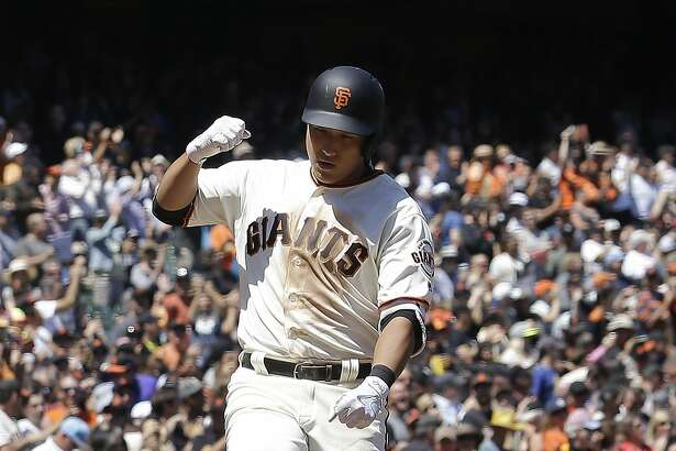 San Francisco Giants' Jae-Gyun Hwang, of South Korea, celebrates after hitting a solo home run against the Colorado Rockies during the sixth inning of a baseball game in San Francisco, Wednesday, June 28, 2017. (AP Photo/Jeff Chiu)