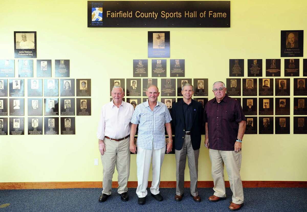 From left, Don LaJolie, Jim Dolan, Laddie Lawrence and John Stratton pose for a photo in front of the Fairfield County Sports Hall of Fame inside UConn Stamford in downtown Stamford, Conn. on Wednesday, June 28, 2017. Dolan and Lawrence are new inductees while LaJolie and Stratton are representing inductees.