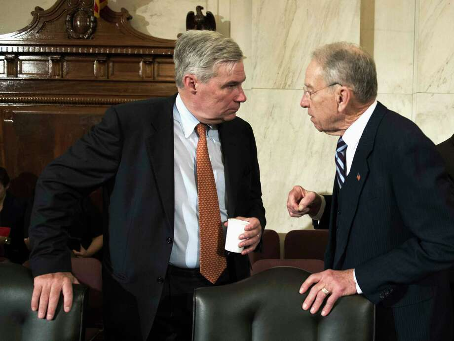 FILE - In this Jan. 11, 2017 file photo, Sen. Sheldon Whitehouse, D-R.I., left, confers with Sen. Charles Grassley, R-Iowa on Capitol Hill in Washington. Bipartisan legislation to limit the influence of so-called shell corporations in the U.S. could get a boost as Congress probes the ways that Russia influenced last year's election.  (AP Photo/Cliff Owen, File) Photo: Cliff Owen, FRE / FR170079 AP