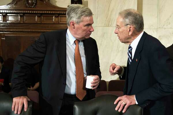 FILE - In this Jan. 11, 2017 file photo, Sen. Sheldon Whitehouse, D-R.I., left, confers with Sen. Charles Grassley, R-Iowa on Capitol Hill in Washington. Bipartisan legislation to limit the influence of so-called shell corporations in the U.S. could get a boost as Congress probes the ways that Russia influenced last year's election.  (AP Photo/Cliff Owen, File)