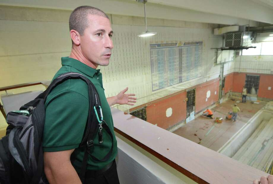 Norwalk High School boys swim coach Chris Passamano looks over the construction site that is the pool at the Spinola Natatorium at Norwalk High School on Aug. 31, 2016. Photo: Alex Von Kleydorff / Hearst Connecticut Media / Connecticut Post