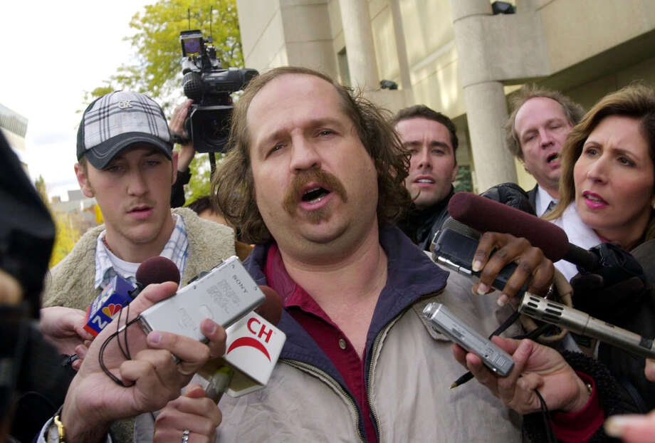 FILE - In this Thursday, Oct. 23, 2003, file photo, Kirk Jones of Canton, Mich., the man who survived a plunge over Niagara Falls, talks to reporters after being released from custody in St. Catherines, Ontario. Jones, who died after plunging over Niagara Falls in an apparent stunt with an inflatable ball might have brought a boa constrictor along for the ride, the Niagara Gazette reported Wednesday, June 28, 2017, that police found a website with a photo of Jones and the snake previewing Jones' plans. An unoccupied large plastic ball he apparently planned to ride over the falls was found empty below the falls in April. (AP Photo/David Duprey, File) Photo: DAVID DUPREY, STF / Copyright 2017 The Associated Press. All rights reserved.