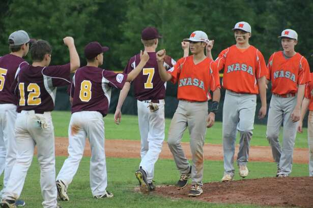 Deer Park's 14-year-old All-Stars and NASA-Orange hold their post-game meeting, following the 12-2 Directors Tournament championship game setback by Deer Park.