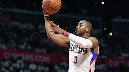 Clippers' Chris Paul drives in for an easy basket against the Utah Jazz in the fourth quarter in Game 1 of the first round of the Western Conference playoffs on April 15, 2017 at the Staples Center in Los Angeles.