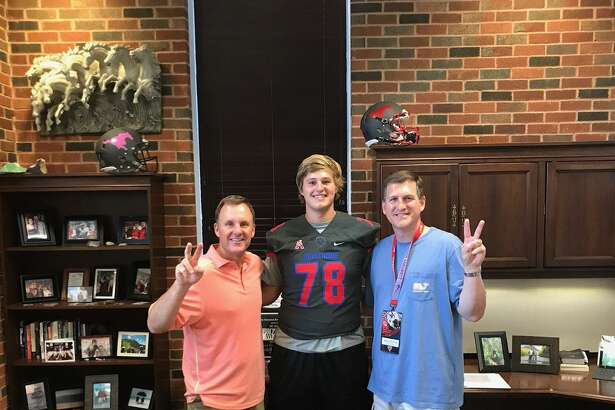 The Woodlands' senior offensive lineman Jake Syptak (center), poses with his father Greg Syptak (left) and SMU head coach Chad Morris (right) during a visit to the SMU campus on June 21, 2017. The Highlander announced his commitment on Twitter two days after his visit.