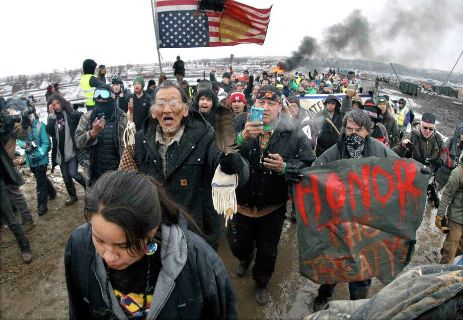 Dakota Access Pipeline protesters march out of their camp in February before the deadline set for evacuation by the U.S. Army Corps of Engineers.   Photo: Mike McCleary, MBO / The Bismarck Tribune