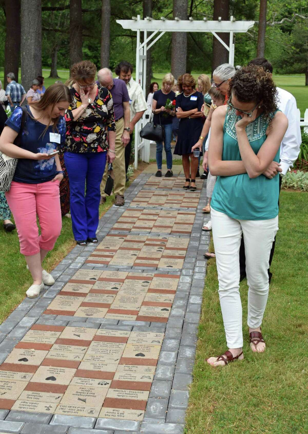 Guests admire the installed walkway at the June 15 ceremony.