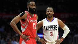 James Harden of the Houston Rockets and Chris Paul of the Clippers look on during the second half at Staples Center on April 10, 2017 in Los Angeles.