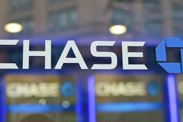 FILE - This Sept. 13, 2014, file photo, shows the Chase bank logo in New York. On Wednesday, June 28, 2017, the Federal Reserve gave the green light to all 34 of the biggest banks in the U.S. to raise their dividends and buy back shares, judging their financial foundations sturdy enough to withstand a major economic downturn. Those allowed to raise dividends or repurchase shares include the four biggest U.S. banks: JPMorgan Chase, Bank of America, Citigroup and Wells Fargo. (AP Photo/Frank Franklin II, File)