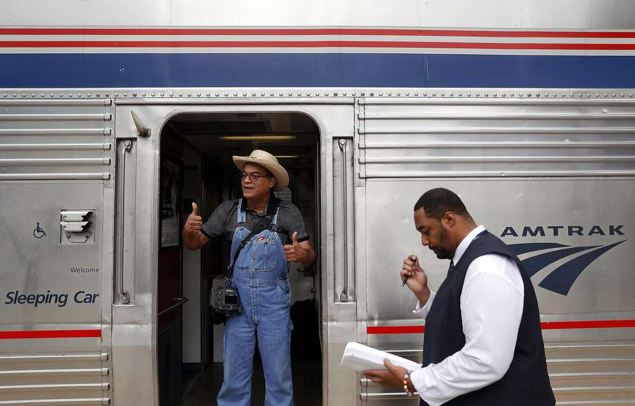 Ray Simons of Castro Valley gives two thumbs up as he boards the Chicago-bound California Zephyr, also threatened with elimination. Photo: Carlos Avila Gonzalez, The Chronicle