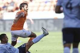 Sporting Kansas City midfielder Roger Espinoza (27) tries to tackle Houston Dynamo defender Kevin Garcia (16) during the first half of the Lamar Hunt U.S. Open Cut Round of 16 game at BBVA Compass Stadium Wednesday, June 28, 2017, in Houston. ( Yi-Chin Lee / Houston Chronicle )