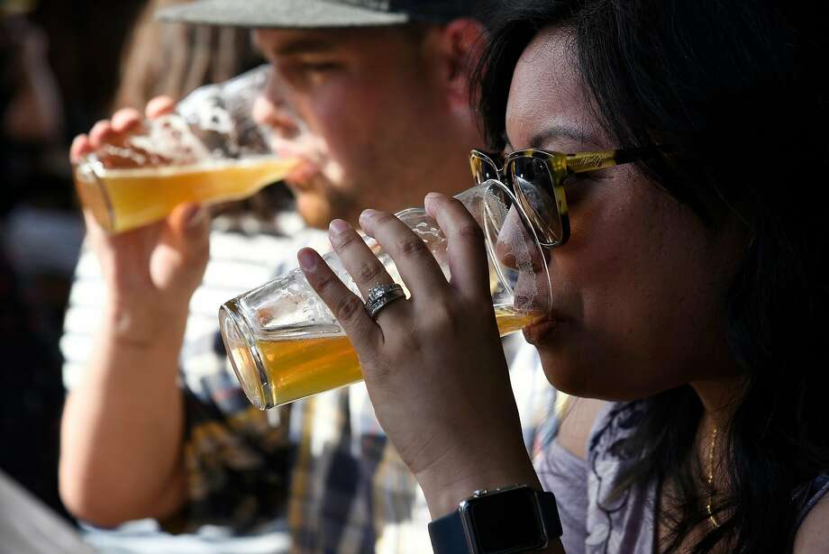 Grace and Rob McGuinness, of Oakland sip their beers at Arthur Mac's Tap and Snack beer garden in Oakland, CA. Beer Nerds will have a similar menu as the East Bay destination. Photo: Michael Short, Special To The Chronicle