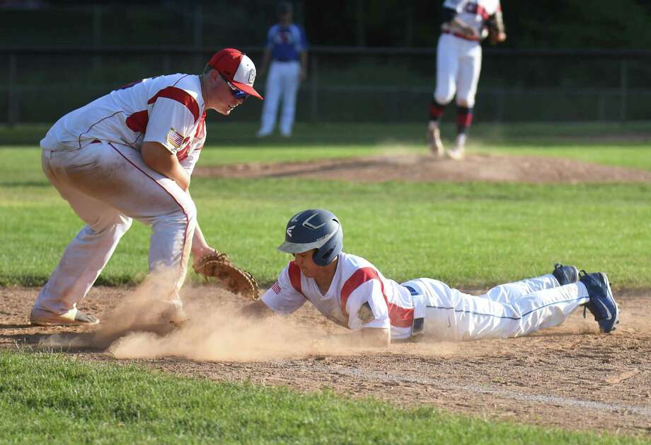Max Gasvoda (31) of the Darien American Legion dives safely back to first base during a game against the Greenwich Cannons at Greenwich High School on June 14, 2017 in Greenwich, Connecticut. Photo: Gregory Vasil / For Hearst Connecticut Media / Connecticut Post Freelance