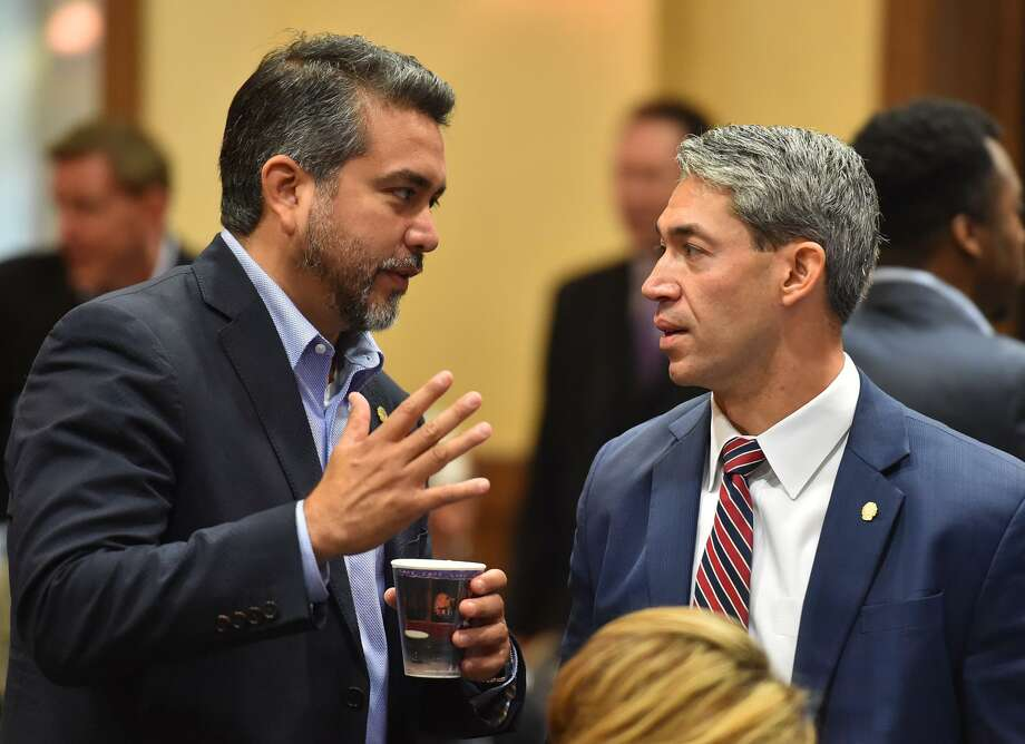 District 1 Councilman Roberto Trevino (left) speaks with Mayor Ron Nirenberg prior to the City Council Fiscal year 2018 Budget Goal-Setting Session Wednesday in the Lonesome Dove Room of the Henry B. Gonzalez Convention Center. Photo: Robin Jerstad /San Antonio Express News / ROBERT JERSTAD