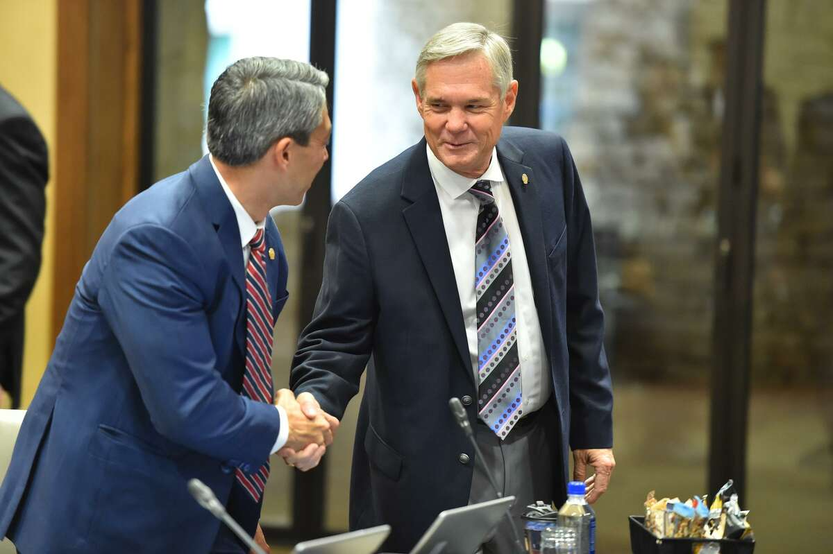 District 10 Councilman Clayton Perry shakes hands with Mayor Ron Nirenberg before the City Council Fiscal year 2018 Budget Goal-Setting Session Wednesday in the Lonesome Dove Room of the Henry B. Gonzalez Convention Center.