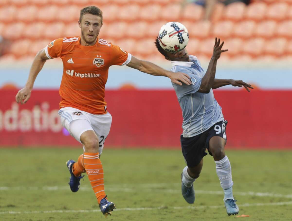 Houston Dynamo defender Taylor Hunter (26) tries to stop Sporting Kansas City forward Latif Blessing (9) during the second half of the Lamar Hunt U.S. Open Cut Round of 16 game at BBVA Compass Stadium Wednesday, June 28, 2017, in Houston. Houston Dynamo lost to Sporting Kansas City 2-0. ( Yi-Chin Lee / Houston Chronicle )