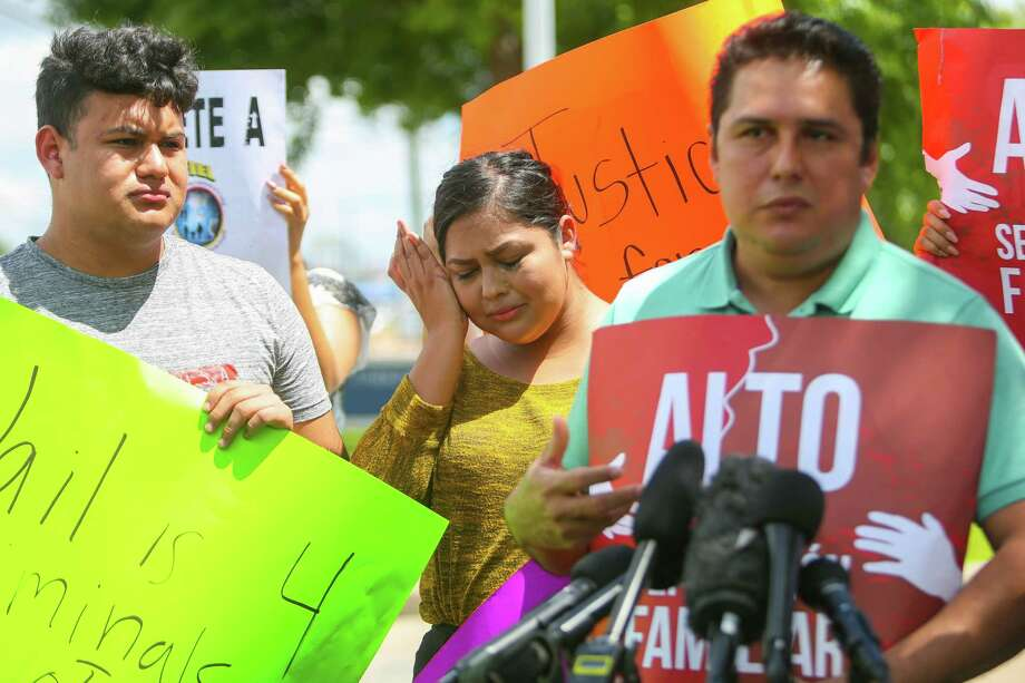 Alejandro Garcia talks about his wife, Lucia Montes, who was detained by Deer Park police during a Monday traffic stop, while his daughter, Alejandra, cries during a news conference outside the Deer Park police department on Wednesday. Photo: Mark Mulligan, Staff Photographer / 2017 Mark Mulligan / Houston Chronicle